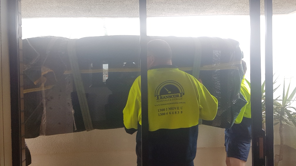 Melbourne Removalists - Crane Loading Off a Balcony