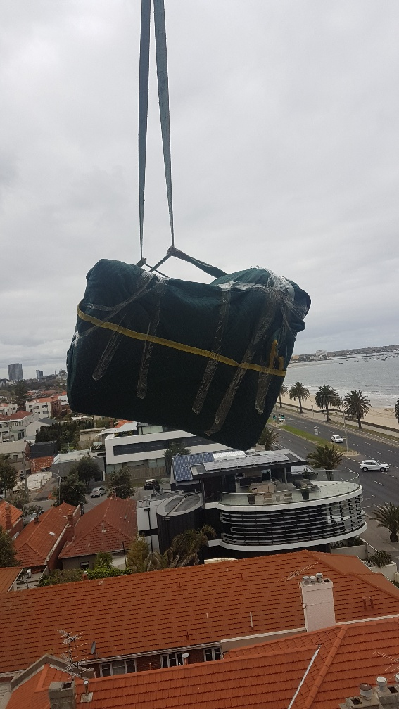 Melbourne Removalists - Crane Loading Furniture Off a Balcony - 7 Floors to Ground