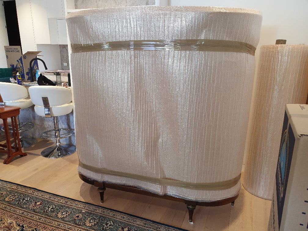 Interstate Removalists Pre- Packing a Crystal Cabinet