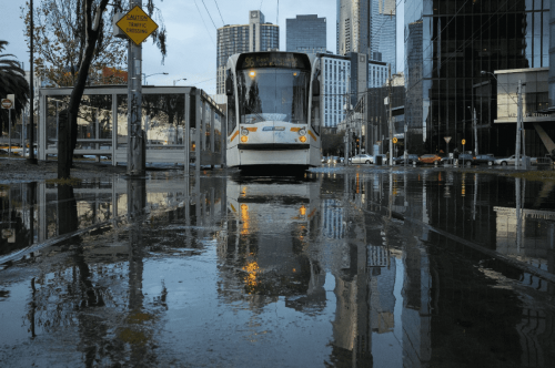 Tram travelling in the Melbourne rain