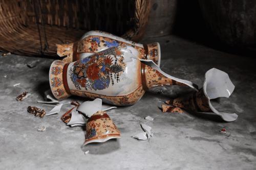 Broken antique vase on the ground